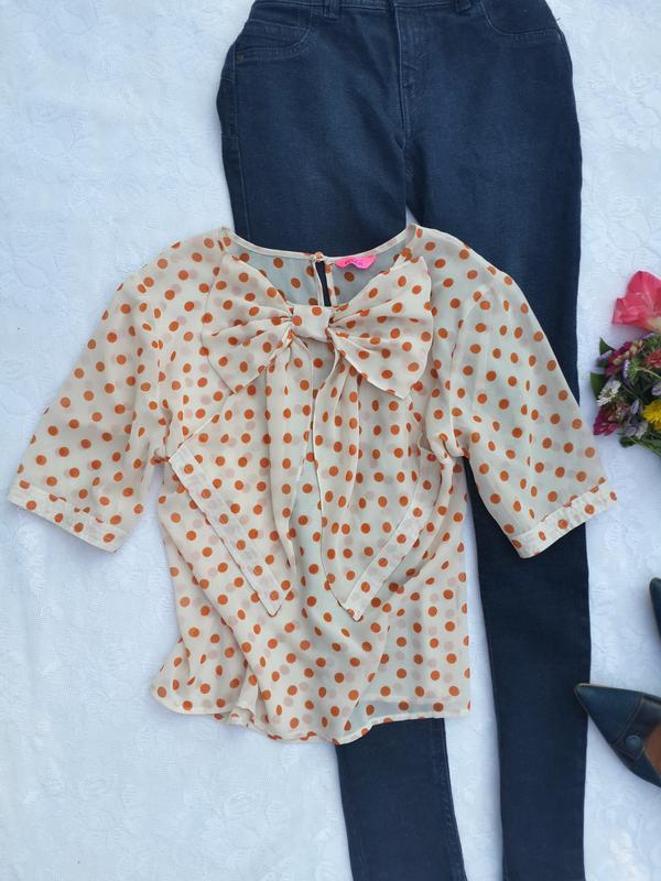 56a9c705dbe Шифоновая блуза в горох украшена спереди бантом Monsoon